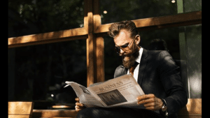 robo advisor news - man reading the newspaper