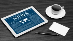 robo advisor news-tablet-coffee cup