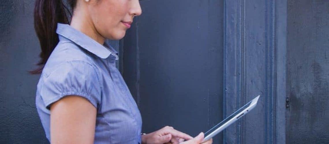 Betterment vs. Ellevest - women with computer