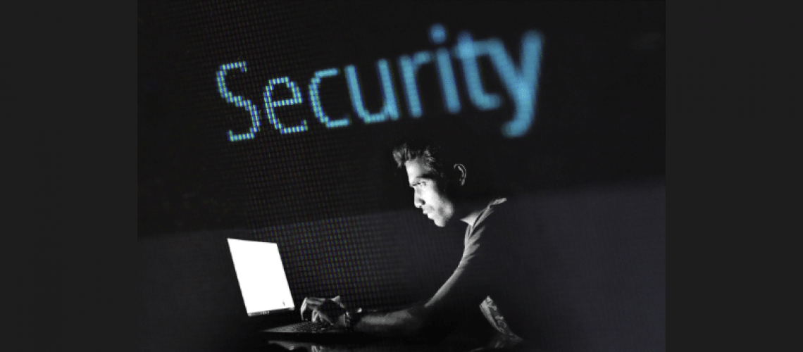 is m1 finance secure-man looking at computer in dark