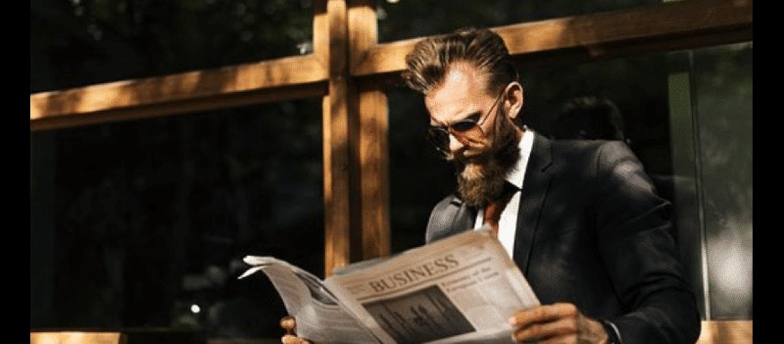 robo advisor news - man reading the newspaper