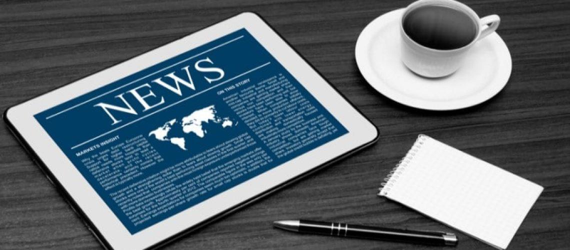 robo advisor news-tablet-coffee cup